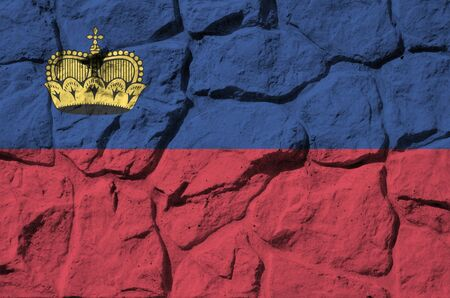 Liechtenstein flag depicted in paint colors on old stone wall close up. Textured banner on rock wall background Stockfoto