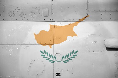 Cyprus flag depicted on side part of military armored helicopter close up. Army forces aircraft conceptual background