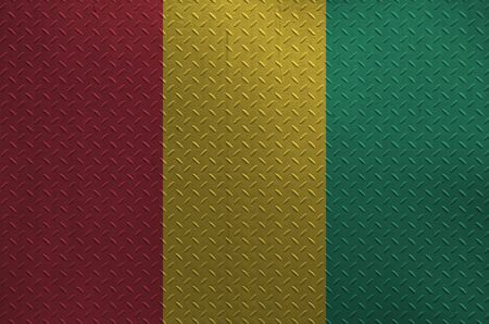 Guinea flag depicted in paint colors on old brushed metal plate or wall close up. Textured banner on rough background Stock fotó