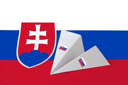Slovakia flag depicted on paper origami airplane. Oriental handmade arts concept Stock Photo
