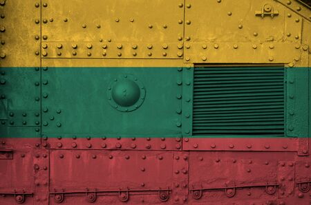 Lithuania flag depicted on side part of military armored tank close up. Army forces conceptual background