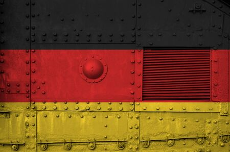 Germany flag depicted on side part of military armored tank close up. Army forces conceptual background