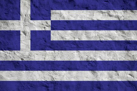 Greece flag depicted in bright paint colors on old relief plastering wall close up. Textured banner on rough background