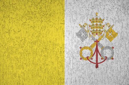 Vatican City State flag depicted in bright paint colors on old relief plastering wall close up. Textured banner on rough background 版權商用圖片