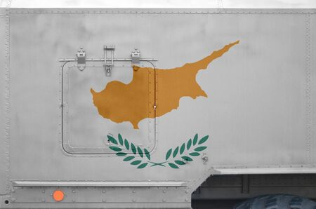 Cyprus flag depicted on side part of military armored truck close up. Army forces vehicle conceptual background Фото со стока
