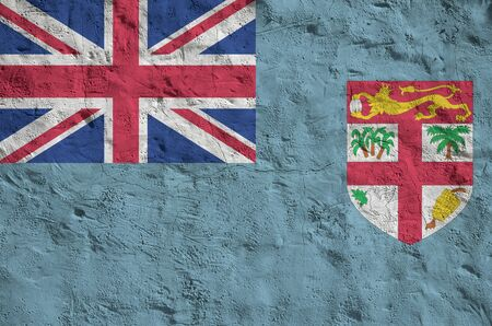 Fiji flag depicted in bright paint colors on old relief plastering wall close up. Textured banner on rough background Stock fotó