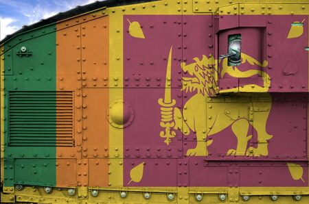 Sri Lanka flag depicted on side part of military armored tank close up. Army forces conceptual background