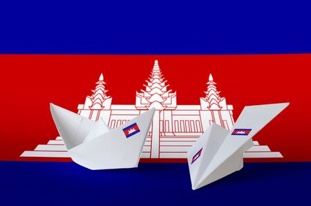 Cambodia flag depicted on paper origami airplane and boat. Oriental handmade arts concept Reklamní fotografie