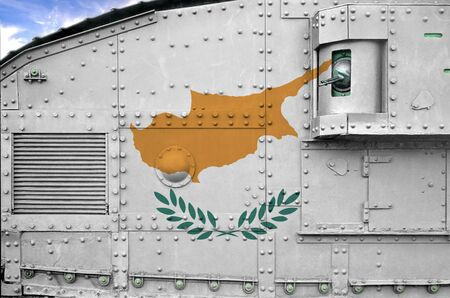 Cyprus flag depicted on side part of military armored tank close up. Army forces conceptual background