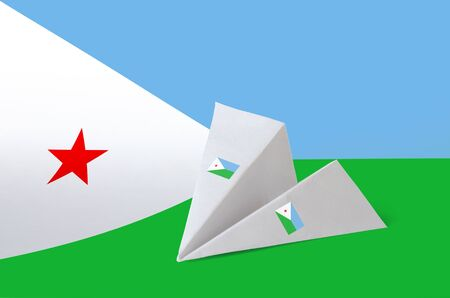 Djibouti flag depicted on paper origami airplane. Oriental handmade arts concept Stock Photo
