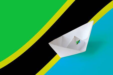 Tanzania flag depicted on paper origami ship closeup. Oriental handmade arts concept Stock fotó