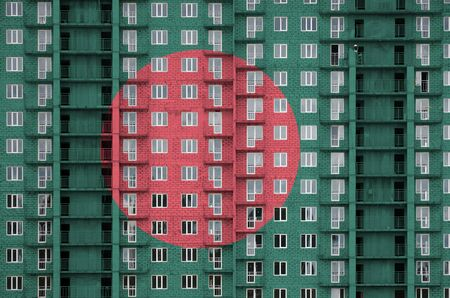 Bangladesh flag depicted in paint colors on multi-storey residental building under construction. Textured banner on big brick wall background Stock fotó