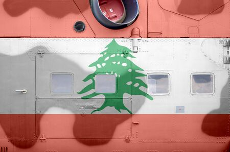 Lebanon flag depicted on side part of military armored helicopter close up. Army forces aircraft conceptual background
