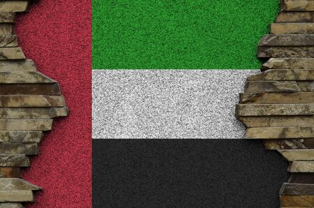 United Arab Emirates flag depicted in paint colors on old stone wall close up. Textured banner on rock wall background Stockfoto