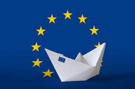 European union flag depicted on paper origami ship closeup. Oriental handmade arts concept