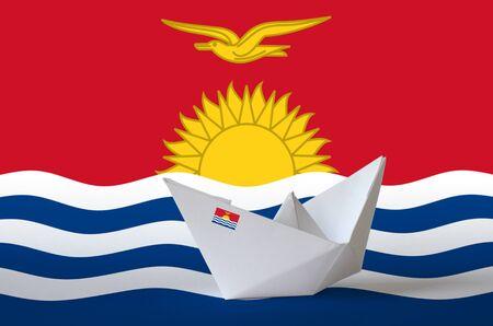 Kiribati flag depicted on paper origami ship closeup. Oriental handmade arts concept