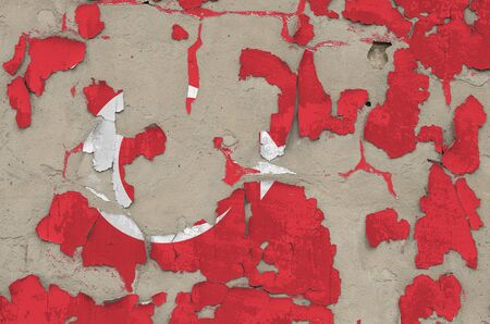Turkey flag depicted in paint colors on old obsolete messy concrete wall close up. Textured banner on rough background