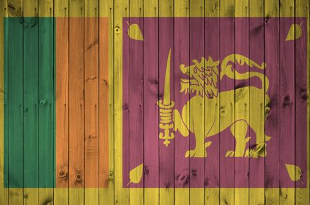 Sri Lanka flag depicted in bright paint colors on old wooden wall close up. Textured banner on rough background Zdjęcie Seryjne