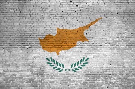 Cyprus flag depicted in paint colors on old brick wall close up. Textured banner on big brick wall masonry background