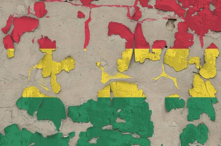 Bolivia flag depicted in paint colors on old obsolete messy concrete wall close up. Textured banner on rough background 写真素材