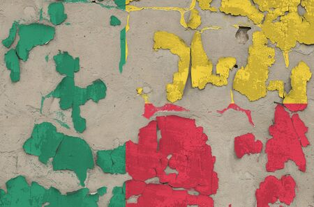 Benin flag depicted in paint colors on old obsolete messy concrete wall close up. Textured banner on rough background