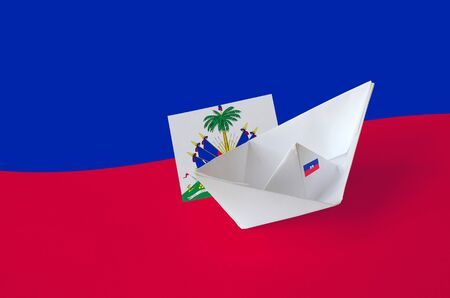 Haiti flag depicted on paper origami ship closeup. Oriental handmade arts concept Stock fotó