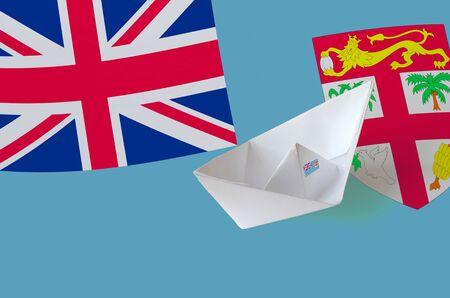 Fiji flag depicted on paper origami ship closeup. Oriental handmade arts concept Stock fotó