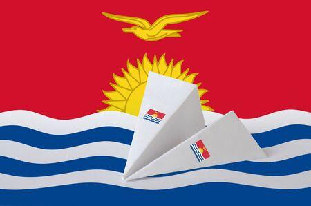 Kiribati flag depicted on paper origami airplane. Oriental handmade arts concept