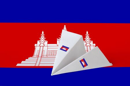 Cambodia flag depicted on paper origami airplane. Oriental handmade arts concept