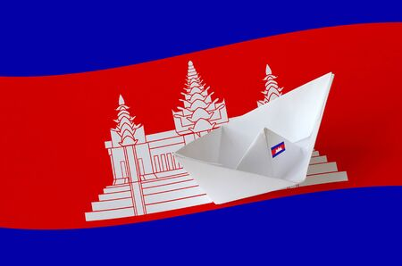Cambodia flag depicted on paper origami ship closeup. Oriental handmade arts concept