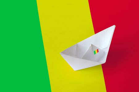 Mali flag depicted on paper origami ship closeup. Oriental handmade arts concept Stock Photo