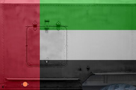 United Arab Emirates flag depicted on side part of military armored truck close up. Army forces vehicle conceptual background Banco de Imagens
