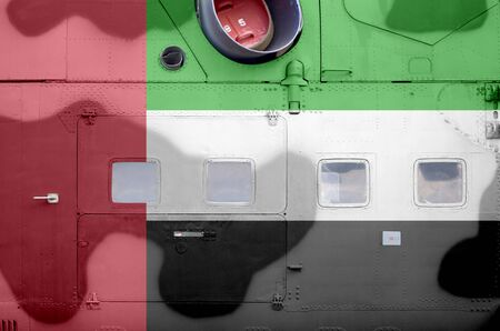 United Arab Emirates flag depicted on side part of military armored helicopter close up. Army forces aircraft conceptual background