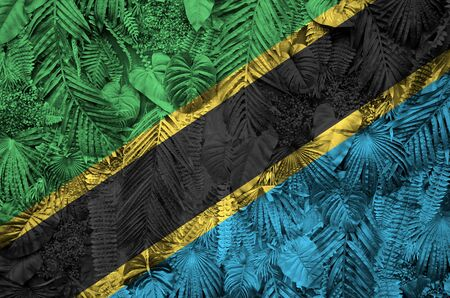 Tanzania flag depicted on many leafs of monstera palm trees. Trendy fashionable background Stock fotó