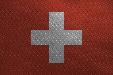 Switzerland flag depicted in paint colors on old brushed metal plate or wall close up. Textured banner on rough background