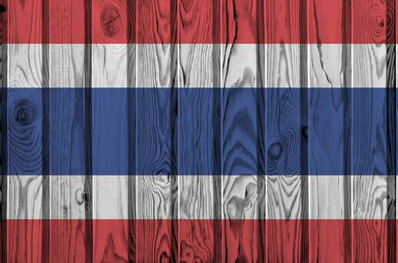 Thailand flag depicted in bright paint colors on old wooden wall close up. Textured banner on rough background Archivio Fotografico