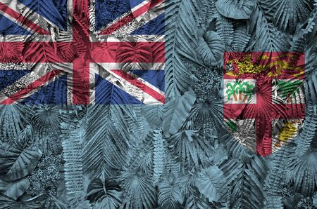 Fiji flag depicted on many leafs of monstera palm trees. Trendy fashionable background