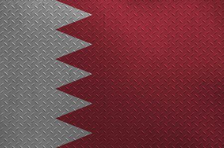 Bahrain flag depicted in paint colors on old brushed metal plate or wall close up. Textured banner on rough background
