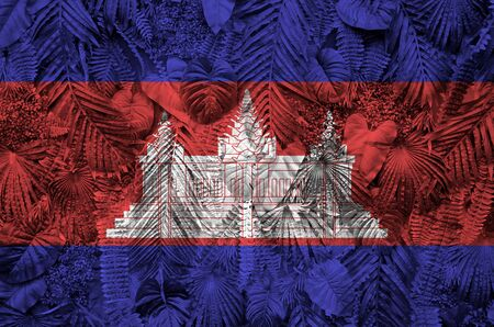 Cambodia flag depicted on many leafs of monstera palm trees. Trendy fashionable background