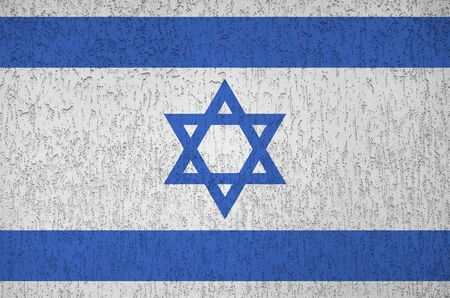 Israel flag depicted in bright paint colors on old relief plastering wall close up. Textured banner on rough background