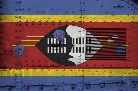Swaziland flag depicted on side part of military armored tank close up. Army forces conceptual background Stock fotó