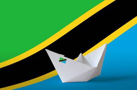 Tanzania flag depicted on paper origami ship closeup. Oriental handmade arts concept