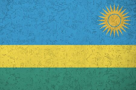 Rwanda flag depicted in bright paint colors on old relief plastering wall close up. Textured banner on rough background Archivio Fotografico