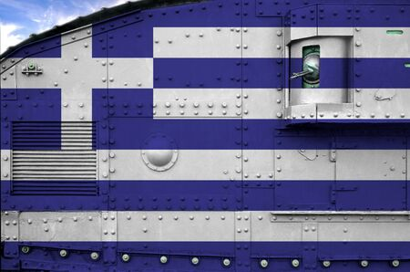 Greece flag depicted on side part of military armored tank close up. Army forces conceptual background