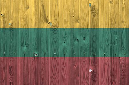 Lithuania flag depicted in bright paint colors on old wooden wall close up. Textured banner on rough background Reklamní fotografie
