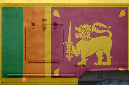 Sri Lanka flag depicted on side part of military armored truck close up. Army forces vehicle conceptual background
