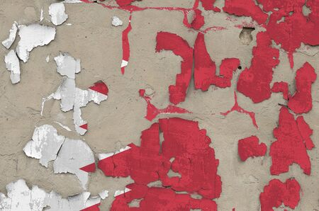 Bahrain flag depicted in paint colors on old obsolete messy concrete wall close up. Textured banner on rough background Reklamní fotografie