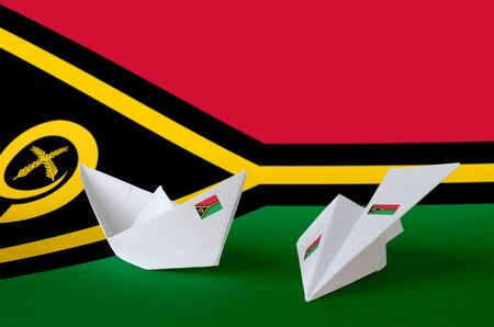 Vanuatu flag depicted on paper origami airplane and boat. Oriental handmade arts concept