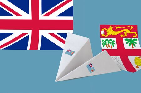 Fiji flag depicted on paper origami airplane. Oriental handmade arts concept
