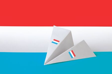 Luxembourg flag depicted on paper origami airplane. Oriental handmade arts concept